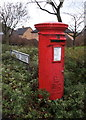 TL4957 : Elizabeth II postbox outside convenience store, Cherry Hinton by JThomas