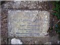 Photo of St John's Well stone plaque