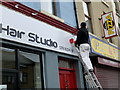 H4572 : Painter at work above Claire's Hair Studio, Omagh by Kenneth  Allen