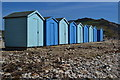 SY3693 : Blue beach huts and blue sky at Charmouth by David Martin