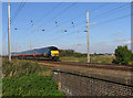 TL1986 : GNER train to London approaching Conington Level Crossing by Andrew Tatlow