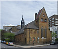 All Souls Church in Loudoun is a mid-Victorian church, built in 1864/1865 to the designs of architects Watmore and Baker. It is Grade II listed - architectural description at this https://historicengland.org.uk/listing/the-list/list-entry/1379350. Declared redundant in 1985 the building has been converted to residential use.