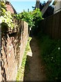 SZ1095 : Throop: slightly leaning brick wall alongside footpath K26 by Chris Downer