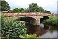NY6423 : The Eden flowing under the sandstone bridge near Bolton by Des Colhoun
