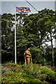 SJ7979 : Wooden Soldier and Flag, Mobberley by Brian Deegan