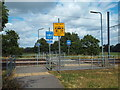 TQ3567 : Tram crossing near South Norwood by Malc McDonald