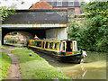 SP6259 : Narrowboat at Weedon Station Bridge by David Dixon