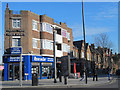 TQ3190 : 1930s shops and flats, High Road / Gladstone Avenue / Buller Road, N22 by Mike Quinn