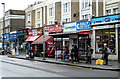 Dist:0.1km<br/>Shops and a bus stop on the west side of the Caledonian Road.