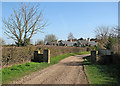 TL5358 : Little Wilbraham: Mill Road and the backs of the almshouses by John Sutton