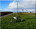SS8077 : Advertising bicycle supported by a pole near Mallard Way, Porthcawl by Jaggery