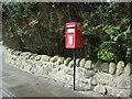 NS7578 : Elizabethan postbox on the A803, Kelvinhead by JThomas