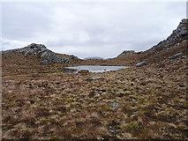 NG9674 : Tiny lochan above the Bealach Mhèinnidh by Richard Law