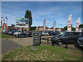 TL4661 : Car sales, Milton Road by Hugh Venables