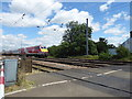 TL1941 : A 125 heading for Langford Level Crossing by Marathon