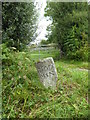 SX0674 : Milestone on a junction on the B3266 north of Hendra by Rod Allday