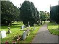 TL1335 : Path in Meppershall churchyard by Humphrey Bolton