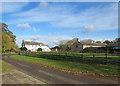 TL6770 : Badlingham: a white house, a paddock and a big flint barn by John Sutton