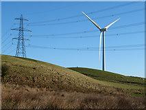 SS9985 : Pylon, wind turbine and trig point on Mynydd Portref by Gareth James