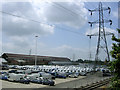SU3912 : White vans in waiting and factory building, Western Docks, Millbrook by Jim Champion