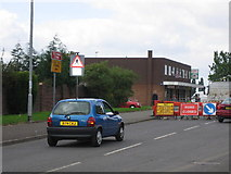 SO9799 : Shops and road works on Stroud Avenue, Willenhall by Angella Streluk