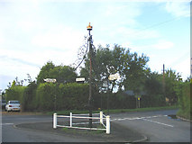 TM2652 : Village Pump and Road Signs, Boulge, Suffolk by John Winfield