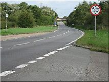 SP7815 : A41 looking west towards railway bridge by Jon S
