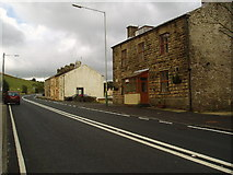 SD8118 : Roadside houses on the A 680 at Turn Village, Lancashire by Dr Neil Clifton