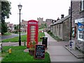 NU1834 : Red telephone box in Bamburgh by David Gruar