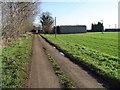 TL2292 : Road leading to Bedford's Barn Farm by Julian Dowse