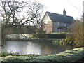 TG2805 : Frozen pond in Kirby Bedon by Graham Hardy