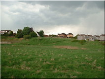 NS8883 : Housing overlooking open land adjacent to New Carron Road, Stenhousemuir by Oliver Dixon
