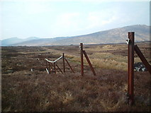 NN3664 : The rail line approaching Corrour and an old snowfence ? by Chris Wimbush