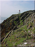 SM7304 : Cliff and lighthouse by dave challender