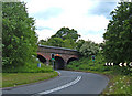 SJ8275 : Railway crossing the A535 by michael ely