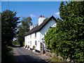 SJ5772 : Burgess Cottage, Norley by Mike Harris