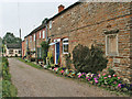 Dist:0.3km<br/>Mellow ironstone cottages in this large commuter village even look good on the dullest of mornings.