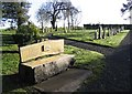 Dist:0.4km<br/>An inscription on the bench seat in the foreground reads:-