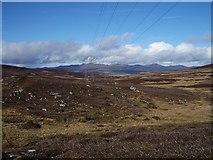 NN8442 : Power line crossing open moorland by Lis Burke