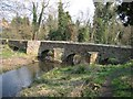 Dist:0.2km&lt;br/&gt;Looking at the ancient packhorse bridge from alongside the River Alyn/Avon Alun.  The additional arches, which appear to be redundant, allow excess water to pass under the bridge at times of flood.  The bridge was badly damaged by floods in November 2000 and was restored in 2001.