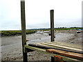TG0044 : Low tide, Morston Quay towards church at Blakeney by Pauline Eccles