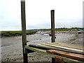 TG0044 : Low tide, Morston Quay towards church at Blakeney by Pauline E