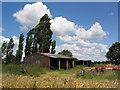TL2778 : Barns near Broughton by Tim Heaton