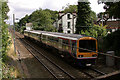 SJ8786 : Train passing through Cheadle Hulme towards Handforth. by Geoff Welding