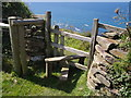 SX1698 : Stile on coast path by Derek Harper