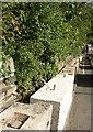 SE1426 : Concrete blocks, Huddersfield Road, Wyke by Humphrey Bolton