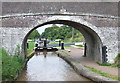 SJ6542 : Snows Bridge and Lock No 7, Shropshire Union Canal, Audlem, Cheshire by Roger  Kidd