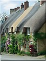 SP4926 : Thatched cottages in High Street Upper Heyford by Michael