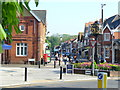 Beyond the Millennium Clock is the main shopping street of this upmarket Surrey village. Many of the shops are still independently owned.