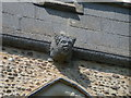 TL3753 : Carved head on east side of church tower by Keith Edkins